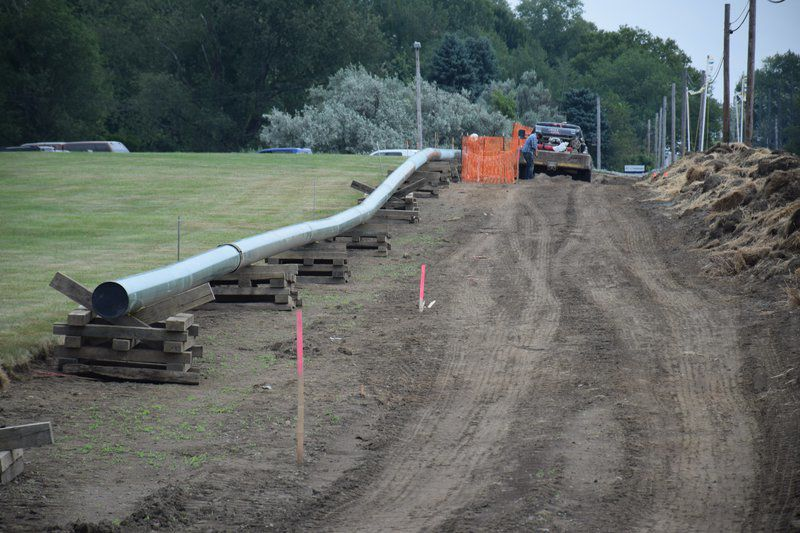 work continues along route 20 on risberg pipeline